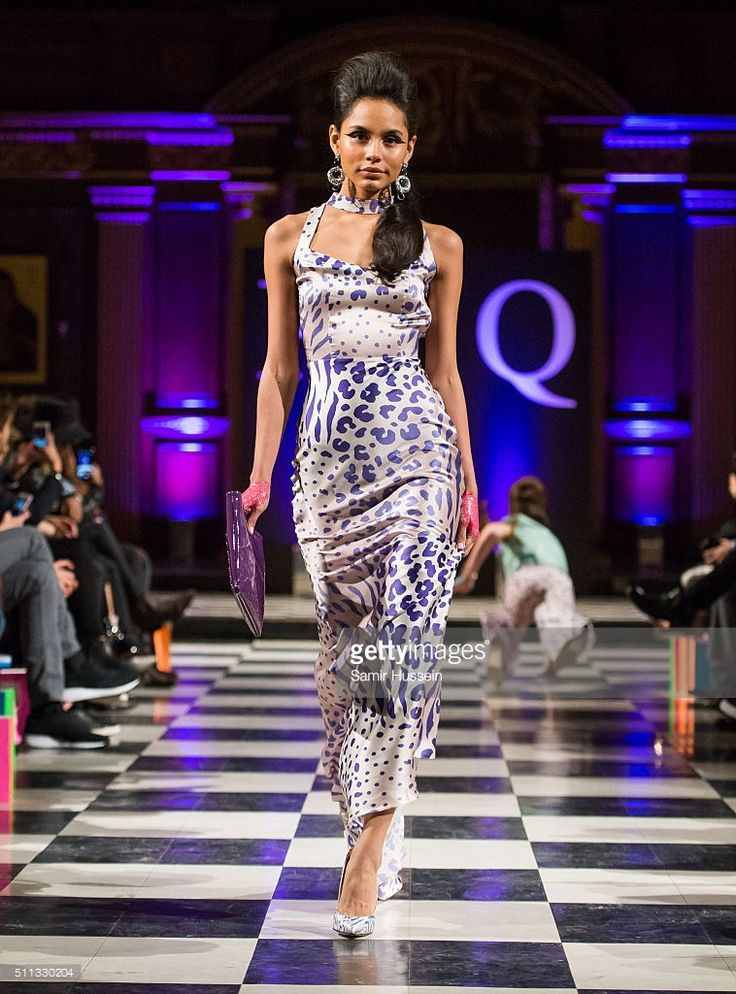A model walks the runway as another model falls (R) at the PPQ show during London Fashion Week Autumn/Winter 2016/17 at St Andrews Church, Holborn on February 19, 2016 in London, England.