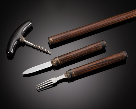 Picnic Cane: This exceptionally rare picnic cane is the perfect accompaniment to dining al fresco. The dark horn T-handle doubles as the handle of a corkscrew, while two upper chambers unscrew to reveal a knife and fork. Similar walking sticks are featured in Cane Curiosa: From Gun to Gadget by Catherine Dike. Excellent condition.