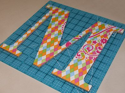 How to perfectly add scrapbook paper to wooden letters. I love this pin! So EASY!
