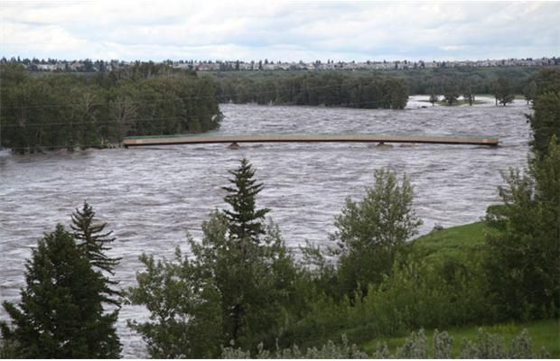 During the flooding of the Bow River in Calgary on June 21, 2013, the pedestrian bridge from Douglasdale to Malard Point in Fish Creek Park is washed out at both ends. Photograph by: Glenda Nakaska-Smith, Submitted  Read more: http://www.calgaryherald.com/story.html?id=8565277#ixzz2Wy706b8O