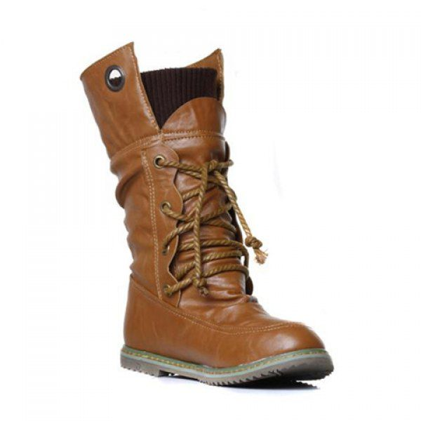 """*AMc: While the horizontal seam is a little too """"deck shoe"""" for me, I am interested in the """"collar-esque"""" tops of these boots and the wavy detail in the eyes for the shoelaces. The soles don't seem like they would have much traction, though."""