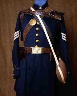 Union Army nine button frock coat  with soft knapsack, canteen, cartridge box with 40 rounds, and cap box. This sgt also wears a NCO belt plate.