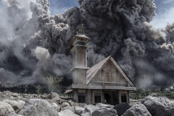 Karo, Indonesia  Ash from Mount Sinabung volcano fills the sky over an abandoned church during another eruption in Karo, in Indonesia's North Sumatra province on June 19
