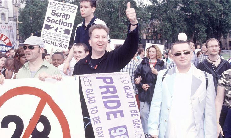 Glad to Be Gay singer Tom Robinson (centre) with Graham Norton and Holly Johnson at the Pride march in London in 1998. Photograph: Piers Allardyce/Rex