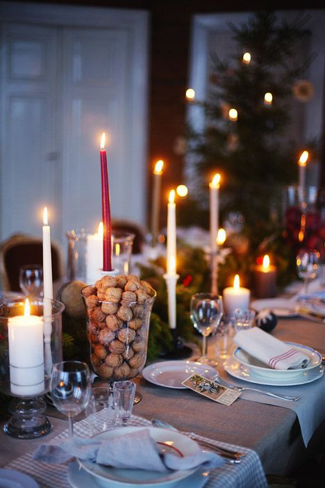 Table scape. Use nuts in a decorative glass container with candles. Keep it natural.