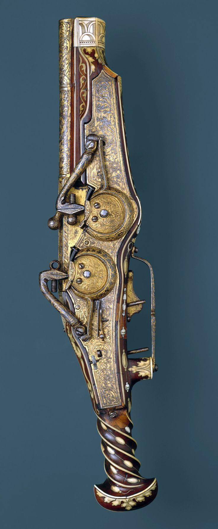 Double-Barreled Wheellock Pistol Made for Emperor Charles V (reigned 1519–56) Peter Peck (German, Munich, 1503–1596). Met Museum.