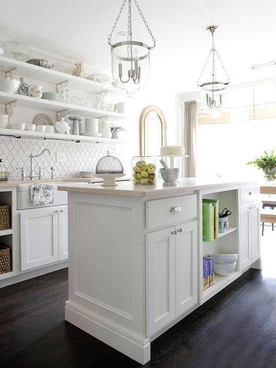 The National Kitchen & Bath Association recommends at least 42 inches between an island and perimeter cabinets and appliances. If multiple cooks use the kitchen, a 48-inch-wide work aisle is recommended. If you want your island to include seating, allow at least 44 inches for walking behind a seated diner and at least 60 inches for wheelchair access.