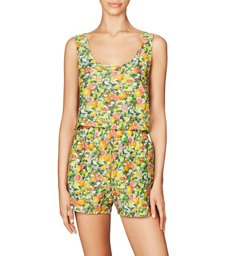 Stella McCartney Swimwear Iconic Prints All In One in Yellow Citrus Print.  Every Stella woman loves the brand's famous citrus print. For swim it comes in classic yellow as well as a new smaller blue motif. Triangle, plunge, bandeau and underwired styles give mix and match choice while multi-coloured beads and mesh inserts make this an ultra feminine offering. Printed shirts, shorts and all-in-ones come in a cotton silk mix.