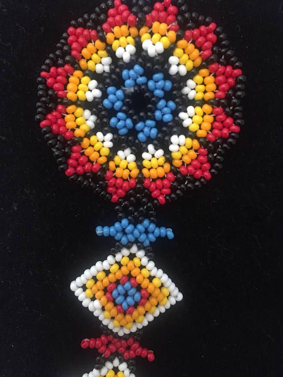 Beautiful Mexican Huichol Art Beaded Adjustable Necklace- This unique piece was hand made in Mexico. Dimensions: The total length of the necklace is roughly 30.7 and has no clasp. Color: Multicolor.