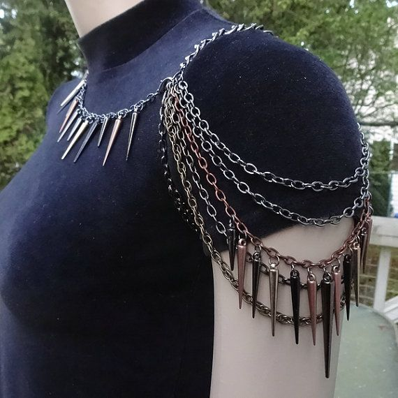 This edgy shoulder chain is made with darker shades of chains and three sized spikes.  Chain colors are gunmetal, hematite, antiqued copper and