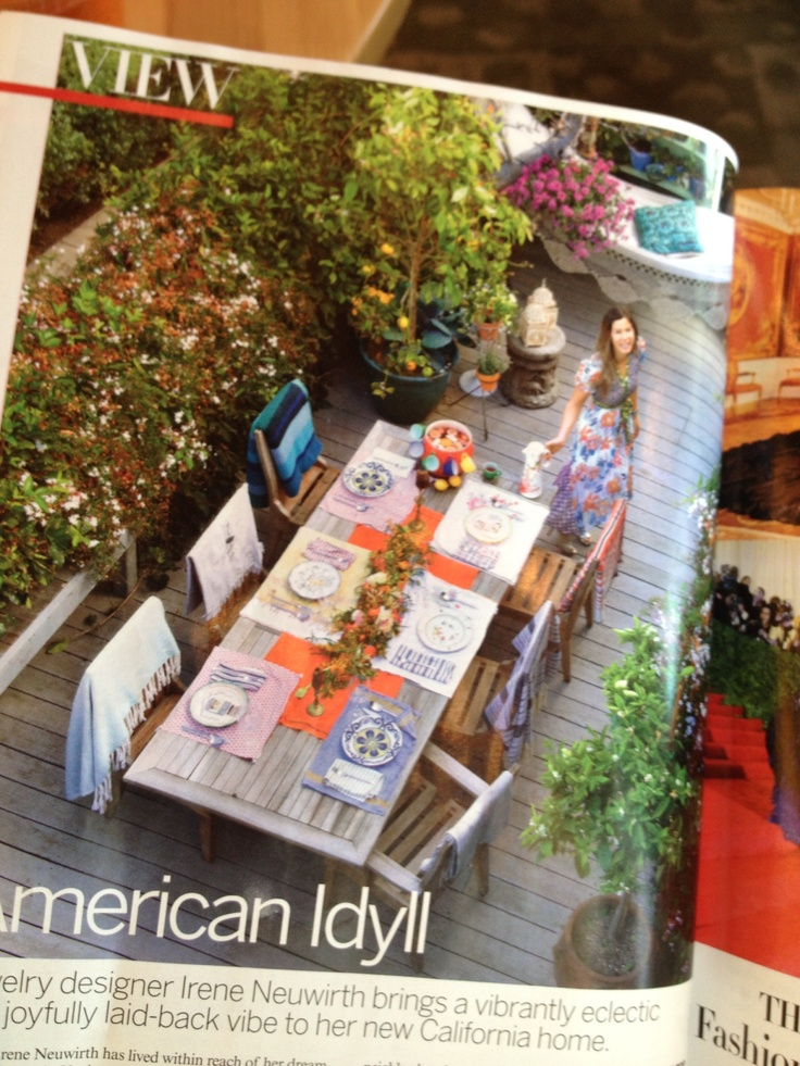 Eclectic outdoor dinner party. Mix of bright prints. Punch bowl w hooks for mugs.