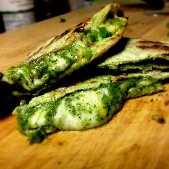 Spinach Pesto Quesadilla on spinach Tortillas. This was different to make. I've never made my own tortillas but they were so yummy the girls ate them up plain. Made the pesto and cooked it in the tortilla with a pinch of cheese and ooooh so good! Everyone ate them up!