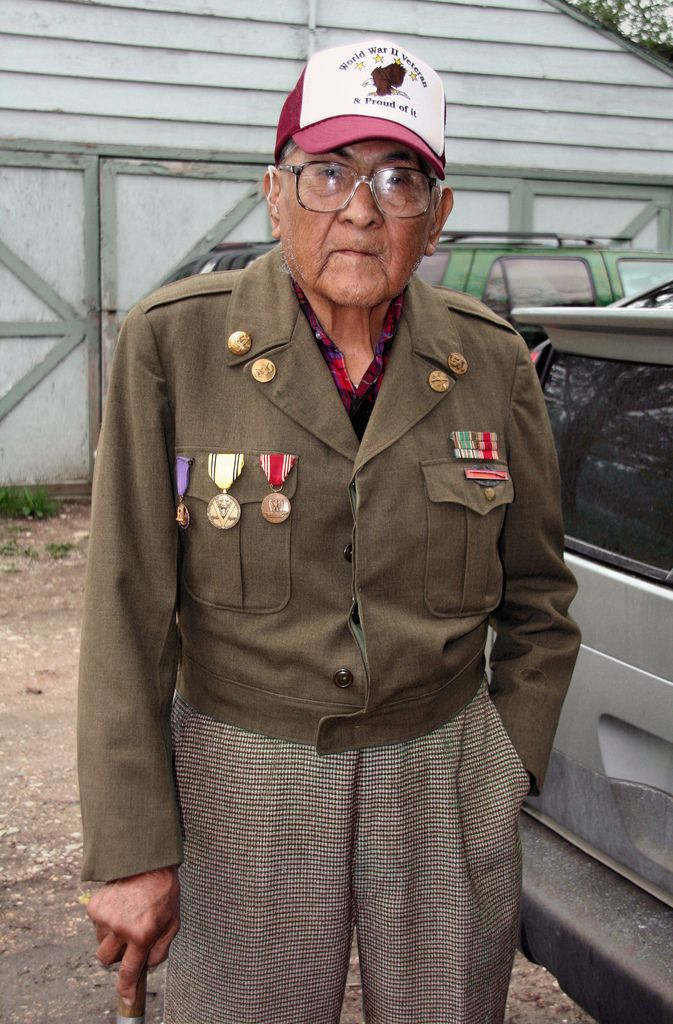 Dr. Joe Medicine Crow outside his home at Lodge Grass, Montana on Memorial Day, 2008. Joe is 94 years old. He is a World War 2 Veteran... Joe's grandfather was Chief Medicine Crow on one side of his family, and White Man Runs Him, Custer's Crow Indian scout at the Little Bighorn on the other side. Joe is also the Crow tribal historian, a position he has held since 1948! Photo by WY Man