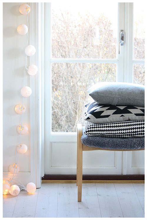 Little paper lanterns and a stack of pillows to snuggle in on a winter day.