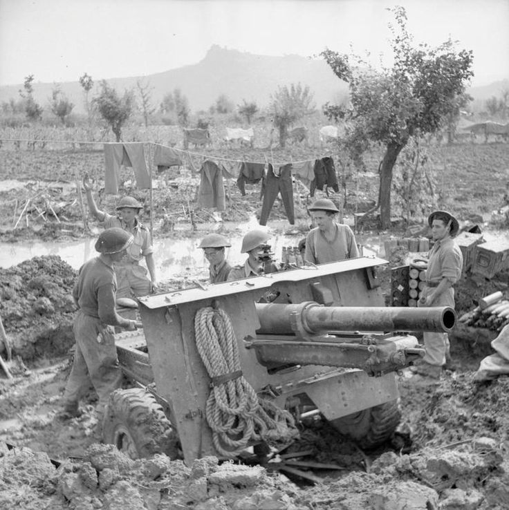 A 25pdr of 83/85 Battery, British 11th Field Regiment in a waterlogged position near Scorticate, Italy, 3-8 October 1944.