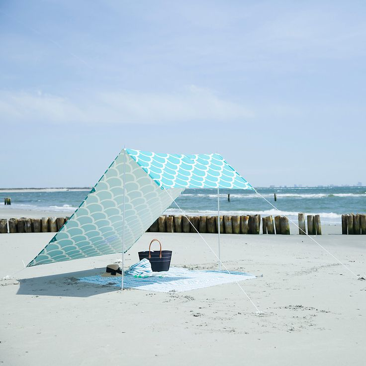 """An innovative way to let the whole family relax in the shade, this cotton beach canopy provides protection from 95% of UV rays. Each colorful, tent-style canopy comes with a lightweight, aluminum frame and tote bag with shoulder straps for easy carrying.- Cotton, aluminum poles, rope, metal pegs- Assembly required- Avoid excessive wind- ImportedCanopy: 71""""W, 130""""LPoles: 6'LOnline Exclusive"""