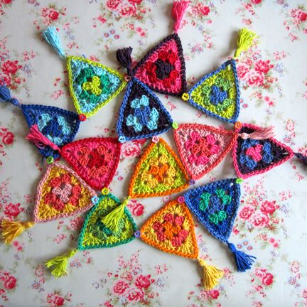 Carnival cotton #crochet bunting would look amazing hung on a wall and framed. The bright colors will bring even the dullest of rooms to life.