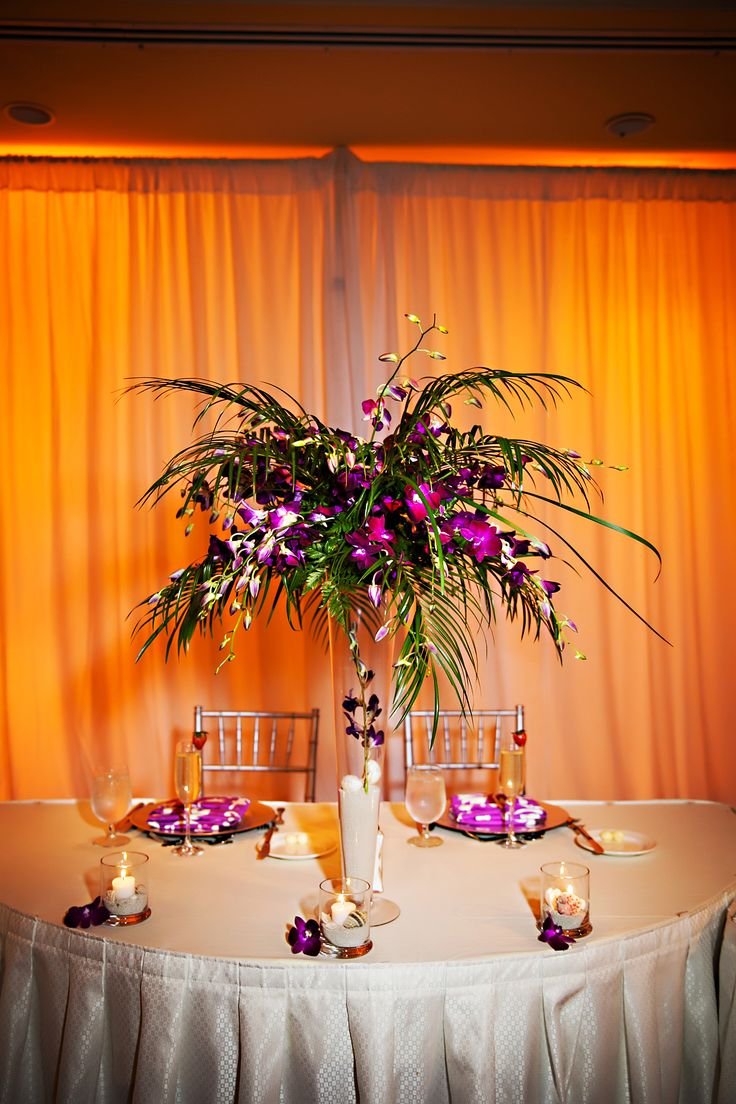 Purple Cymbidium Orchids And Palm Tree Leaf Centerpiece