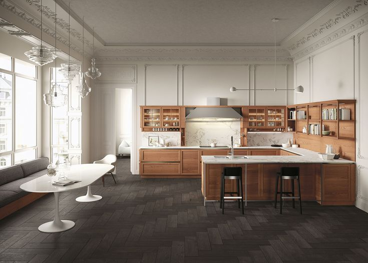 Heritage. A modern kitchen design that delivers timeless appeal by evoking traditional Italian culture and using artfully molded surfaces. The end result is a luxury kitchen with sober elegance and balanced allure.
