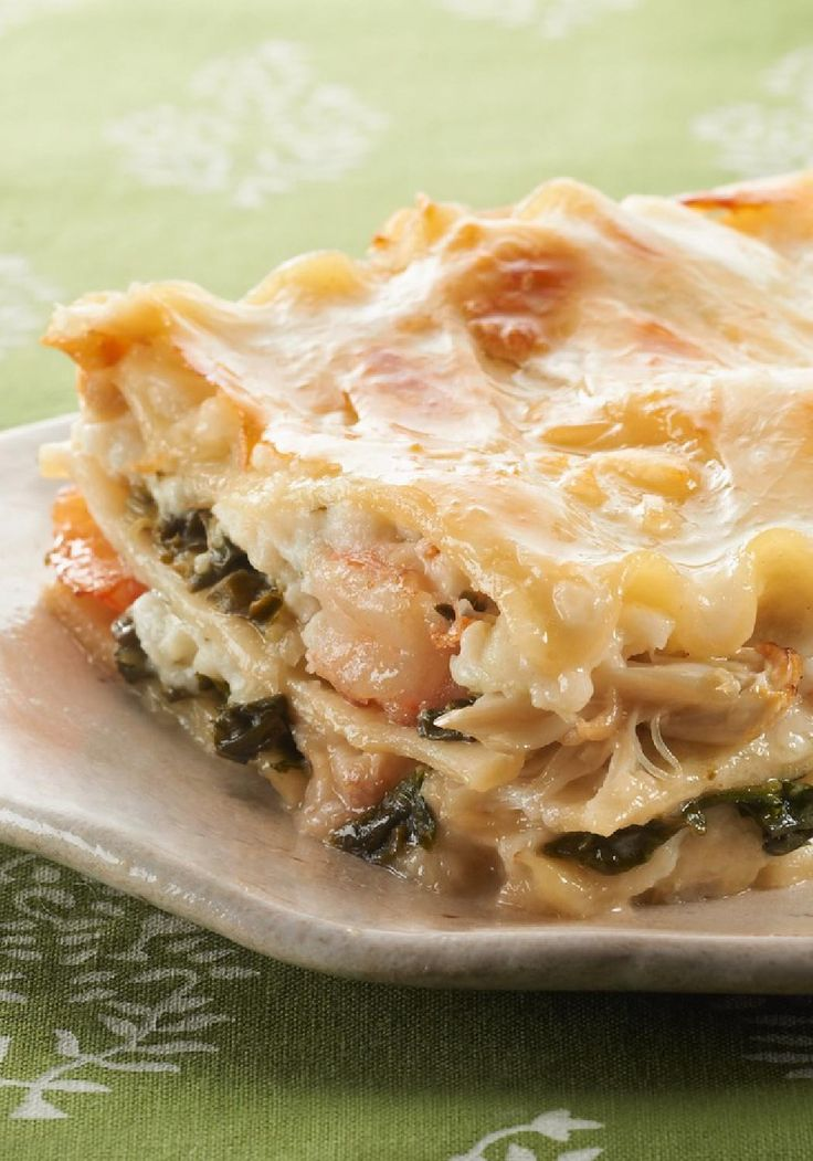 No-Fail Baked Seafood Lasagna — Our creamy Parmesan sauce pairs perfectly with spinach, shrimp and crab for a new take on lasagna that's an easy way to get your family eating seafood.