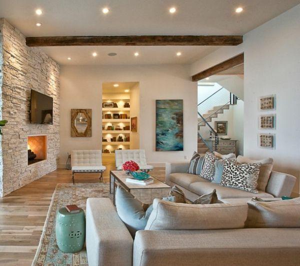 Salle de séjour avec un mur en pierre -bien aménagé