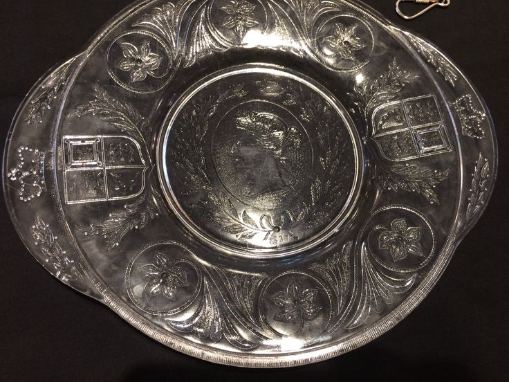 A Queen Victoria handled glass tray 11.75 inches wide which was made by the Nova Scotia Glass Co in 1887 to commemorate Queen Victoria's 50th year on the throne (note the 1837 coronation date on the plate).