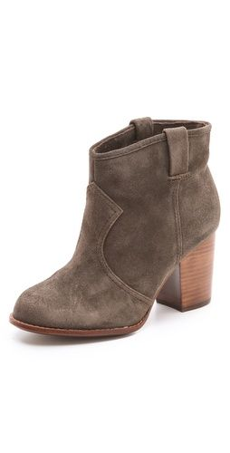 This grey suede bootie with a stacked heel offers a sturdy lift and pretty details.