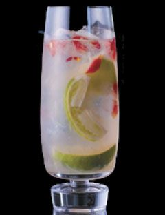 Coming Up Roses  1/2 lime, sliced into wedges  1/2 oz. Monin Rose Syrup  6 drops rosewater  3 rose petals  2 oz. Bacardi Razz  2 oz. brut Champagne
