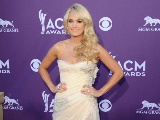 Country Stunner Carrie Underwood shines on the red carpet! #ACMAwards