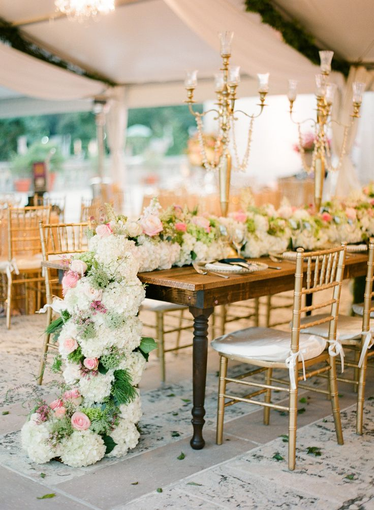 Oh my WOW! A huge garland of hydrangeas+++ for the centerpiece. Never seen anything so beautiful! See the wedding on SMP here: http://www.StyleMePretty.com/2014/05/28/romantic-glamour-in-miami/ Floral Design: InesNaftali.com -- Photography by KTMerry.com