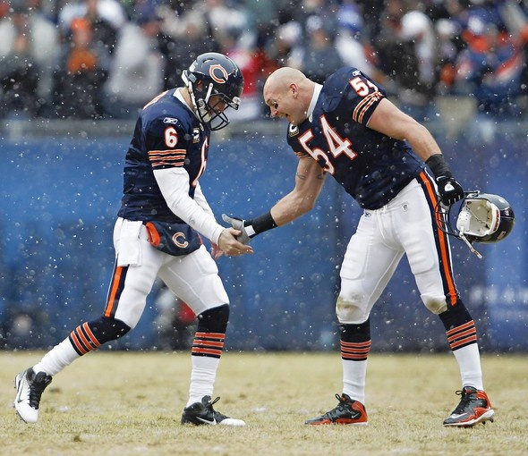 Chicago Bears' quarterback Jay Cutler (6) and linebacker Brian Urlacher (54) celebrate a touchdown pass to Greg Olsen