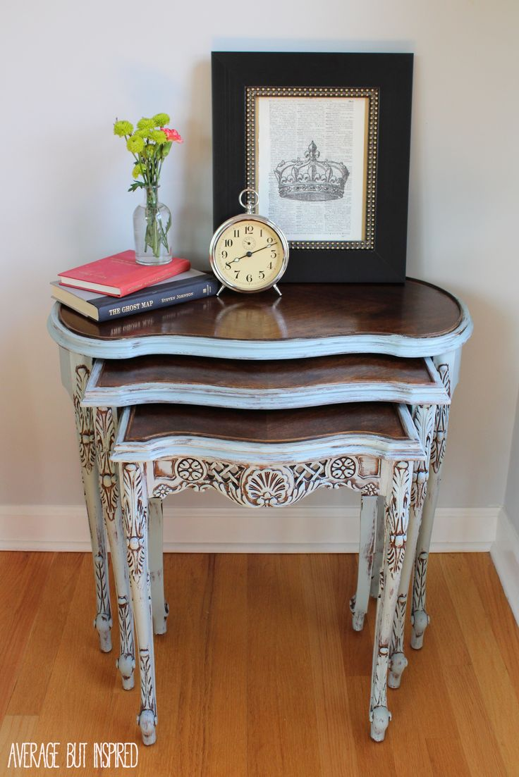 These painted nesting tables did NOT used to be so pretty! Come find out how some dark walnut stain and light blue paint made them gorgeous again!