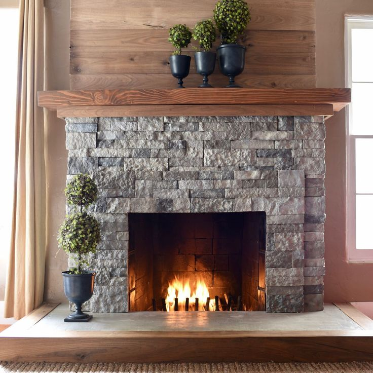 Airstone fireplace makeover airstone fireplace airstone for Diy rock wall fireplace