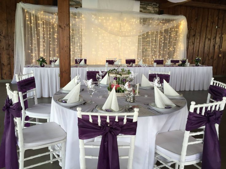 wedding decoration and chair with purple and white