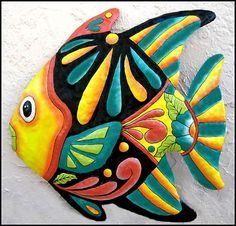 Tropical metal art - Metal wall art - Tropical fish art - Brightly hand painted metal tropical fish wall decor. Measures 24 x 24.  This metal art tropical fish wall hanging was hand cut from a 55 gallon upcycled - recycled steel drum, in Haiti, using a hammer and chisel. The various details of the gecko were pounded out into a bas-relief, so that the details are more visible. A rust preventative solution is applied to the steel. The tropical fish is then hand painted in rich colors. It is…