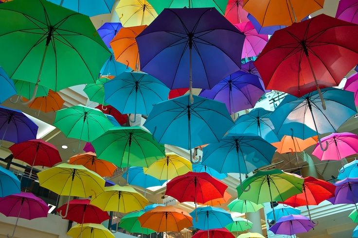 Umbrellas....this would be a great idea for an outdoor wedding...with the bride's color theme....different..