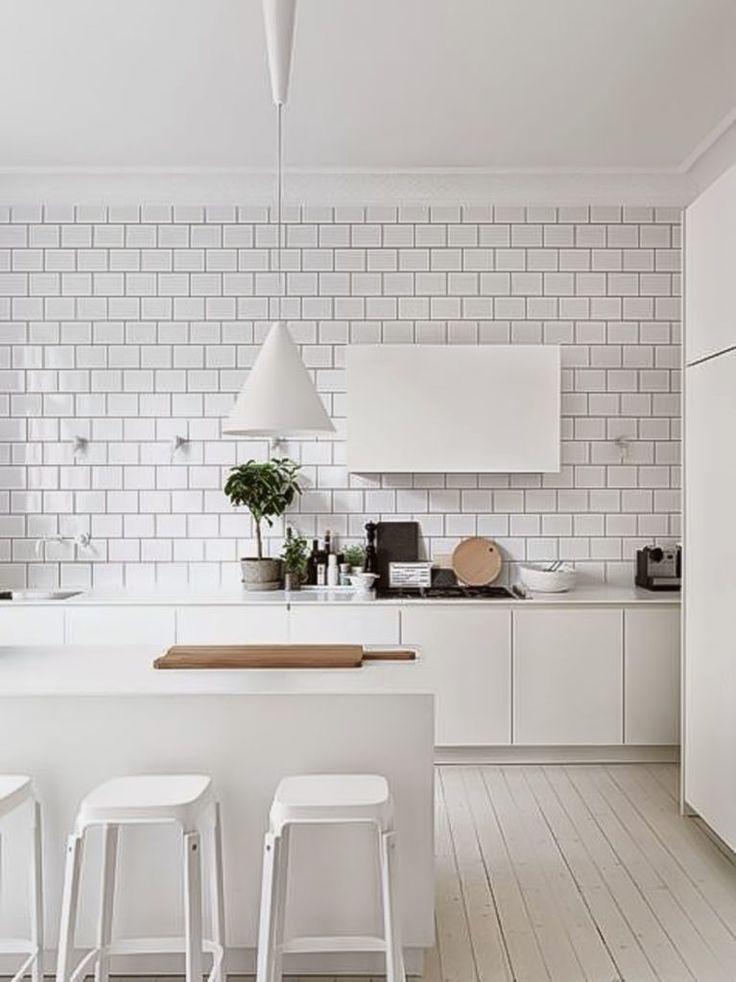 Totally white stylish kitchen with metro tiles