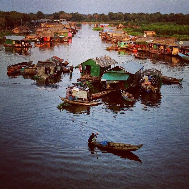 natgeo~~ A boat returns in the evening  to the floating village of Pean Bang on #Cambodia's Tonle Sap lake. iPhone photo by @dguttenfelder on assignment this week for @natgeo. @instagram