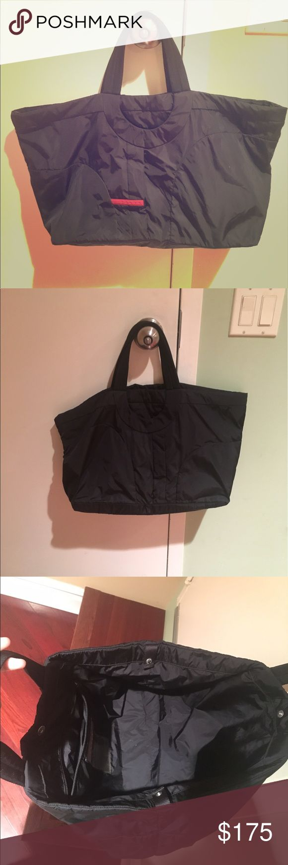 Authentic Prada Nylon Tote Bag Great condition, TONS of room in the bag, very spacious with one side pocket, 100% nylon, made in Italy. Offers accepted :) Prada Bags Totes