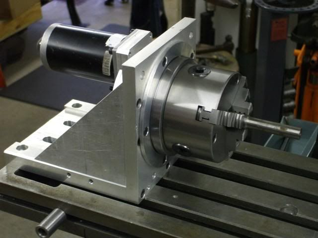 CNC Rotary Indexer by Holescreek -- Homemade CNC rotary indexer constructed from surplus aluminum stock, a stepper motor, and an online-souced fixture. http://www.homemadetools.net/homemade-cnc-rotary-indexer