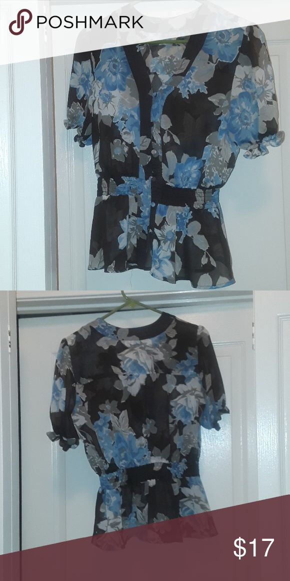 EUC Sheer flowers Blouse In great condition. No tears, stains, or rips. I wore this blouse three times. I have too many blouses. The blouse goes in near the waist and ruffles out subtly. The blue flowers with the neutral colors make this blouse a staple in your wardrobe. You can wear this to work or an event with trousers, jeans, or a skirt. And accessorize this piece with flower jewelry or gold toned jewelry. Material: 100% polyester. The shirt can be washed in a washing machine, making…