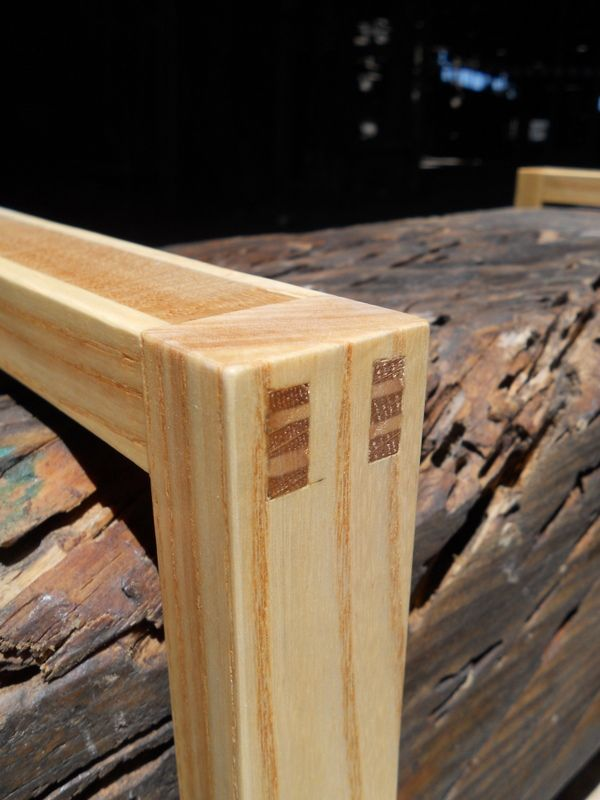 A wedged mortise-and-tenon joint in ash and oak.
