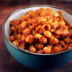 Warm up with a hot and spicy bowl of chana masala - fast, cheap, and easy chickpea curry.