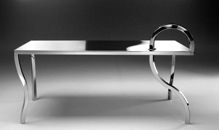 ANOMALIE Collection design Gio Minelli Collection made of polished stainless steel, handmade. Table dimensions: 180x80xh76 cm