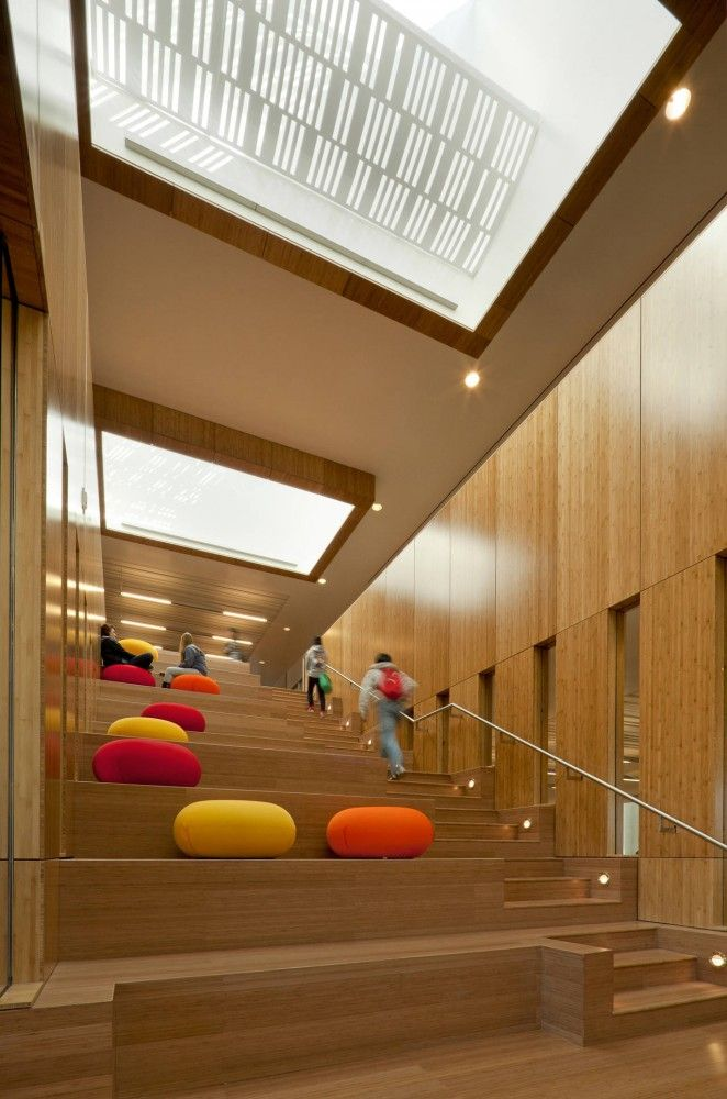 This is not a typical stairway. The added bean bags creates the feeling that it is ok and welcomed to sit and gather on the stairs while in between classes or on breaks.