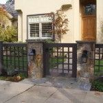 : Fresh Front Yard Wood Fence with Stone Columns