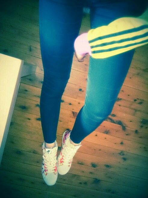Three stripes. :) Adidas Supestar wedges by Rita Ora... Love them! They're sooo comfy and matching everything.