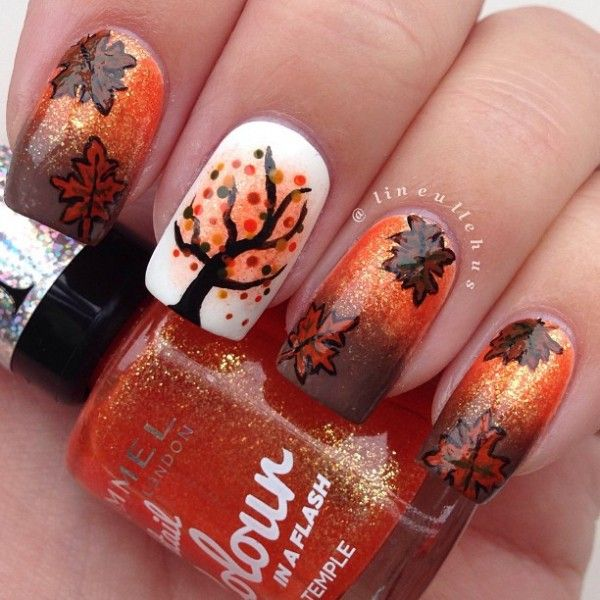 Pretty leaf nail art design in orange and brown color combination. Mix up the shades of orange and brown with white and black to produce an afternoon sunset like feel to the environment which makes your nails look warm and eye catching.
