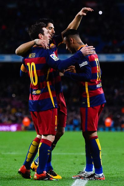Neymar (R) of FC Barcelona celebrates with his teammates Lionel Messi (L) and Luis Suarez of FC Barcelona after scoring his team's sixth goal during the La Liga match between FC Barcelona and Celta Vigo at Camp Nou on February 14, 2016 in Barcelona