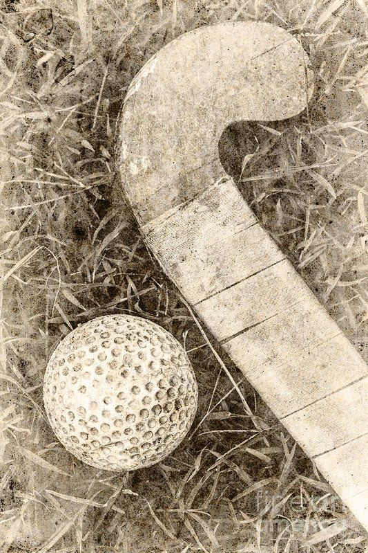 Traditional old paper photo of a taped up field hockey stick next to dimpled ball. Old-fashioned sport artwork by Ryan Jorgensen